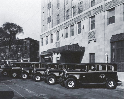 Taxi stand at the Faust Hotel, early 1930s.