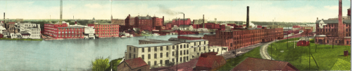 The W.F. and John Barnes Company factory building on the east bank of the Rock River. The factory is the red building with the smoke stack on the center right