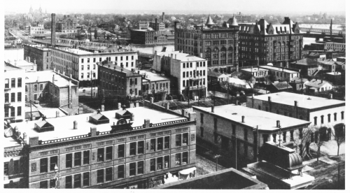 The Nelson Hotel, to the right of the Brown Building, dominates Rockford's west side at the turn of the 20th century.