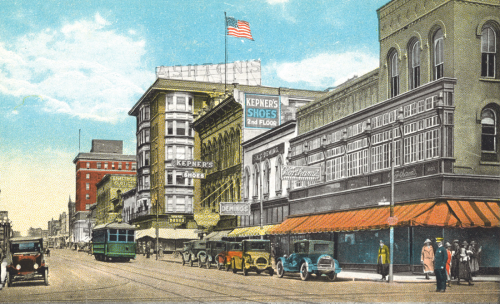 Colorized postcard of West State Street showing the Richardson Building when it was part of Wortham's Department Store, late 1920s.
