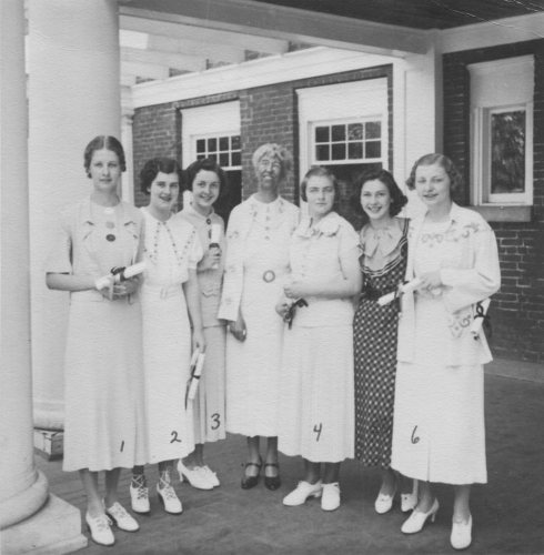 Principal Nancy Philbrick with students in front of the Shoudy House, 1935.