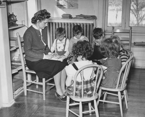 Mrs. Ginny Merz listens to students reading, 1948.